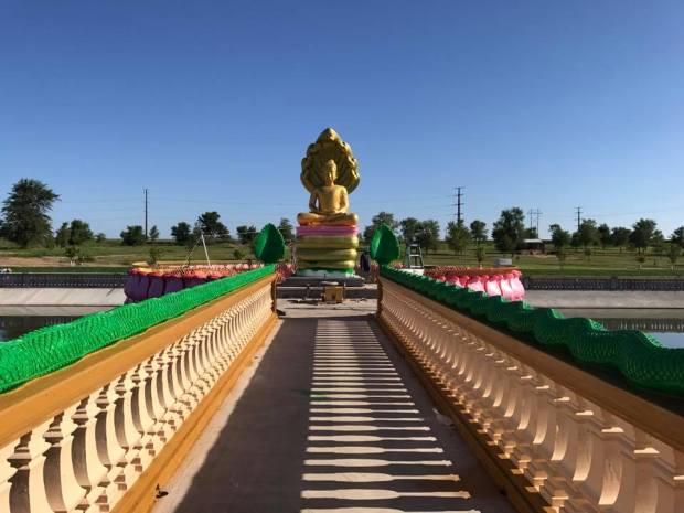 A Muchalinda (reflection) Pond at Watt Munisotaram in Hampton includes a 20-foot tall statue of Buddha. (Courtesy of Watt Munisotaram)