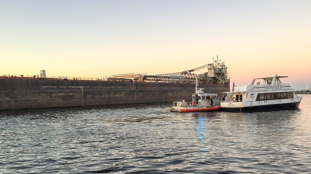 A 1,000-foot laker passes very close to the Vista Queen of the Vista Fleet early Thursday morning, Sept. 21, 2017, in the Duluth Harbor. Someone unmoored both the Vista Queen and Vista Star and they were found floating free in the harbor. (Photo courtsey of the DECC via Forum News Service)