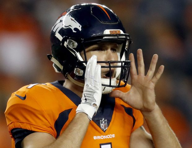 Denver Broncos quarterback Kyle Sloter (1) makes a call agasint the Arizona Cardinals during the second half of an NFL preseason football game, Thursday, Aug. 31, 2017, in Denver. (AP Photo/David Zalubowski)