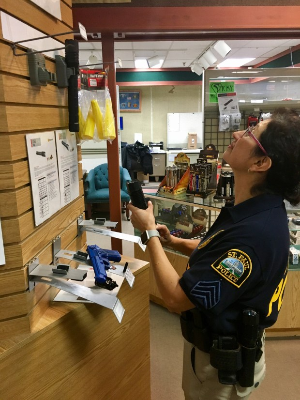 St. Paul Police Acting Commander Pamela Barragan searches for flashlights to take to Puerto Rico. She and nine other St. Paul police officers are heading to Puerto Rico for two weeks at the beginning of October in the aftermath of Hurricane Maria. (S. M. Chavey / Pioneer Press)