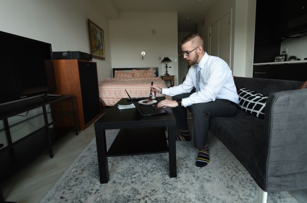 Jack Knutson, a 28-year-old banker, eats lunch and works on the internet in his apartment at The Ray, a new apartment building in St. Paul's Midway area, on Wednesday, Sept. 6, 2017. Knutson has lived in the 372-square-foot apartment since the end of July. (Scott Takushi / Pioneer Press)