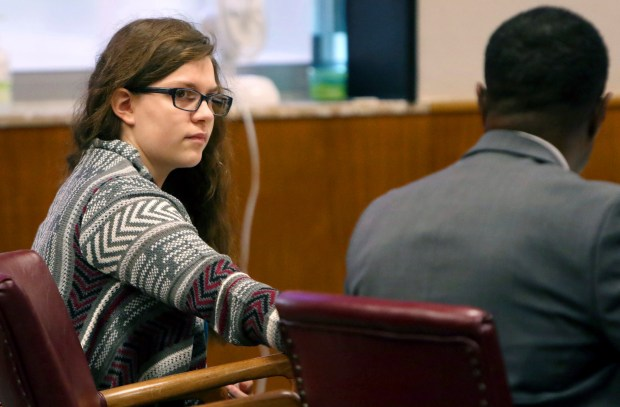 Anissa Weier passes a note to defense attorney Joseph Smith Jr. during closing arguments in her case before Waukesha County Circuit Court Judge Michael Bohren on Friday, Sept. 15, 2017, in Waukesha, Wis. Weier is accused of helping her friend stab their classmate nearly to death to please online horror character Slender Man. (C.T. Kruger /Milwaukee Journal-Sentinel via AP, Pool)