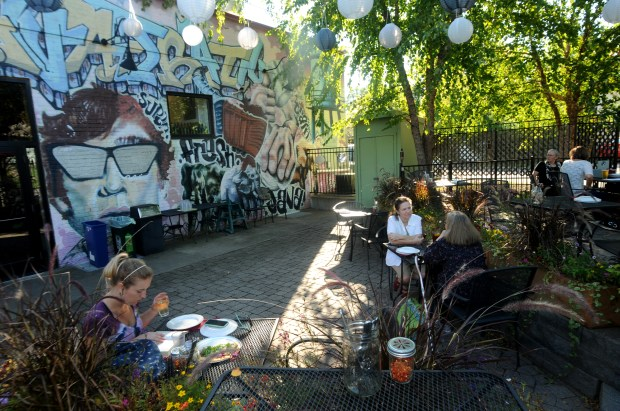 The patio at Delicata, 1341 Pascal St. just off Como Avenue in St. Paul, includes a multi-level terrace with a colorful graffiti wall, hanging lanterns and lots of greenery on Wednesday, Sept. 20, 2017. (Ginger Pinson / Pioneer Press)