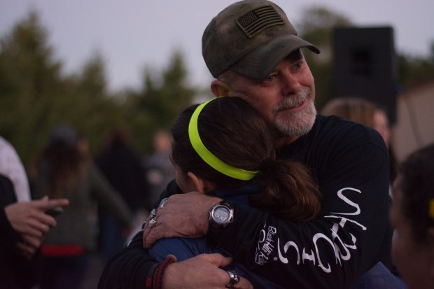 Jasmine Block spent much of the time at the gathering embracing community members who came out to welcome her back. (Beth Leipholtz | Forum News Service)