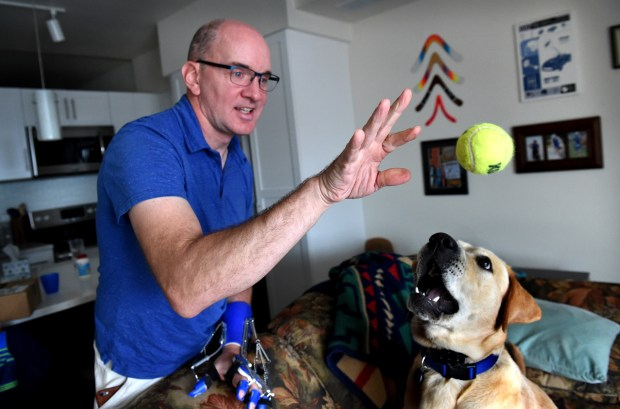 When Mark Kedrowski was getting ready to do his left-hand exercises, his therapy dog, Enzo, brought a tennis ball to him to throw in White Bear Lake on Wednesday, Sept. 6, 2017. Kedrowski, a pilot, was nearly killed in a plane crash seven years ago near the Lake Elmo airport. After more than 50 surgeries and a trial in Ramsey County, his attorneys won a $27.7 million verdict against Lycoming Engines (the designer and seller of the airplane's fuel pump) and Kelly Aerospace Power Systems. The verdict was reversed six months later. Now the Minnesota Court of Appeals will make a decision. (Jean Pieri / Pioneer Press)