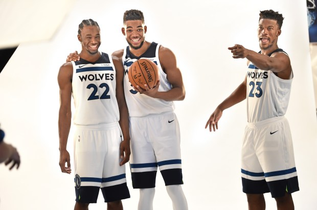From left, Minnesota Timberwolves Andrew Wiggins, Karl-Anthony Towns, and Jimmy Butler clown around as team photographer David Sherman tries to take their photo real fast as time had run out at the Timberwolves Media Day at Mayo Clinic Square in Minneapolis Friday, Sept. 22, 2017. (Jean Pieri / Pioneer Press)