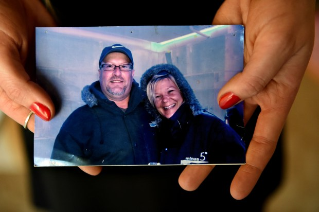 """They (parents) and my sister are the reason I got through it. They are the reason I got back to me,"" said Ellla Dorner as she shows a picture of her parents, Jeff and Jules Dorner, on Friday, Sept. 22, 2017. Dorner, who is now a motivational speaker, sustained a traumatic brain injury after falling down steps in her Stillwater home in 2008 at age 15. She had to relearn who her parents were. For the first several days after hitting her head and being diagnosed with retrograde amnesia, Dorner forgot not only her entire life before the accident, but also each day of recovery. (Jean Pieri / Pioneer Press)"