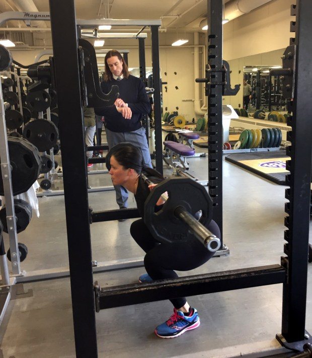 Kari Turkowski trains with strength coach -- and fellow Ironman Triathlon teammate -- Brett Bruininks at St. Thomas University in St. Paul during May 2017. (Courtesy of Erin Higgins)