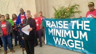 The Rev. James Erlandson speaks in support of a $15 minimum wage Tuesday, Sept. 26, 2017, outside St. Paul City Hall. (Frederick Melo / Pioneer Press)