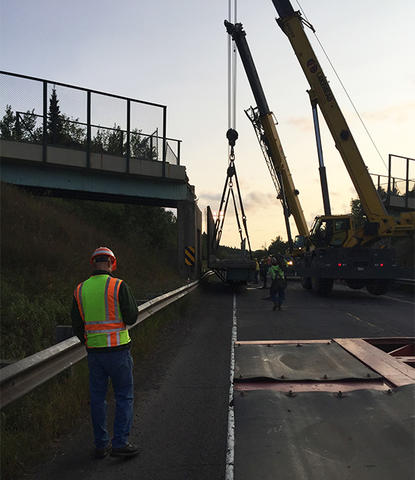 Demolition crews remove a railroad bridge early Friday, Sept. 1, 2017, over Minnesota Highway 61 near Taconite Harbor after a truck struck and damaged it Thursday. (Minnesota Department of Transportation photo)
