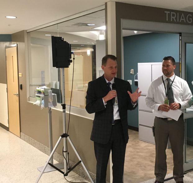 United Hospital President Tom O'Connor unveiled renovations to the emergency care center on Tuesday, Sept. 12. David Schmoyer, right, is the emergency department director. (Ryan Faircloth / Pioneer Press)