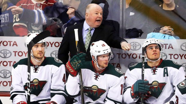 Minnesota Wild coach Bruce Boudreau gives instructions to his team during the first period. (Trevor Hagan/The Canadian Press via AP)