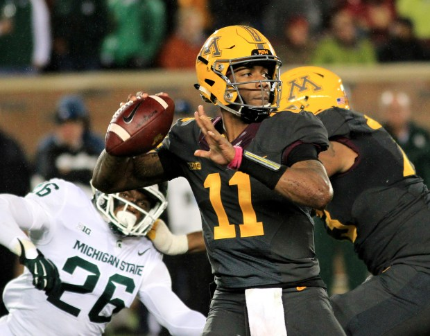 Minnesota quarterback Demry Croft looks to pass against Michigan State during the third quarter of an NCAA college football game on Saturday, Oct. 14, 2017, in Minneapolis. Michigan State defeated Minnesota 30-27. (AP Photo/Andy Clayton-King)