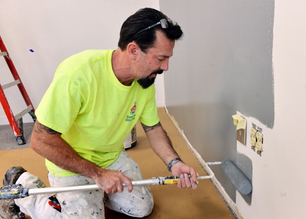 Paul Korn, who is taking part in the first federal re-entry court initiative in Minnesota, paints an office in downtown Minneapolis, October 26, 2017. Korn, who served 20 years in federal prison on a drug distribution charge, is a participant in the program which involves judges, probation officers, prosecutors, public defenders and assigned mentors meeting frequently with released offenders.  (Pioneer Press / Scott Takushi)