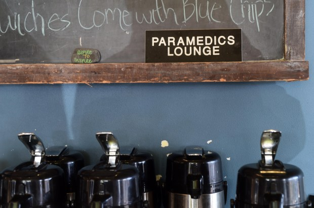 Lakeview Hospital paramedics frequently enjoy a free cup of coffee at the Daily Grind coffee shop in downtown Stillwater, October 24, 2017. John Greenberg established a HERO fund to provide free coffee for cops, firefighters, paramedics and others. ( Scott Takushi: Pioneer Press)
