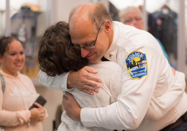 Jasmine Block and Alexandria Police Chief Rick Wyffels share a hug after the Block family is presented with the reward money. Jasmine's mom, Sarah, is smiling at left. (Beth Leipholtz / Echo Press)