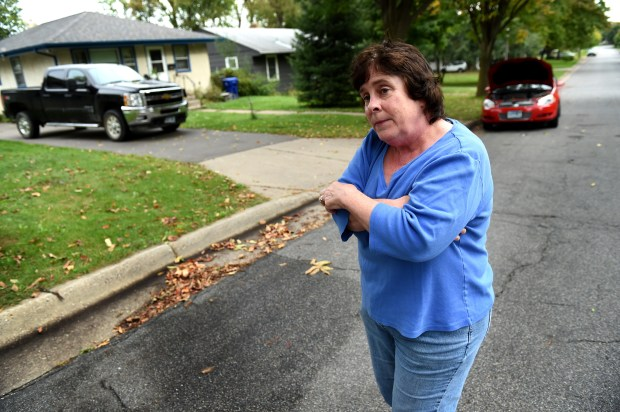 """It's not our first round with this kind of thing -- Guy Harvey Baker --"" said Bridget Krieglmeier on Friday, Oct. 6, 2017. Krieglmeier, a 32-year resident who lives right by where there was a fatal shooting on Euclid Street in the Dayton's Bluff neighborhood about 6 p.m. Thursday. Her red Impala has at least five shots in it. St. Paul police officers fatally shot a man Thursday after they were called to ""a violent domestic"" in which the man fired a gun at a woman.  (Jean Pieri / Pioneer Press)"