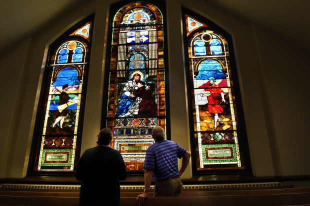"""Mark Seeley, right, and Reverand Shawna Horn, left, look over stained-glass windows at Fairmount Avenue United Methodist Church in St. Paul on Wednesday, Oct. 18, 2017. The church will mark its 100th year at its present location near Macalester College with a series of anniversary celebrations. In preparation for the centennial, the 125-year-old windows have been refurbished. Seeley, the church historian, is a climatologist at the University of Minnesota and a climate commentator on MPR's """"Morning Edition"""" and TPT's """"Almanac."""" (Jean Pieri / Pioneer Press)"""