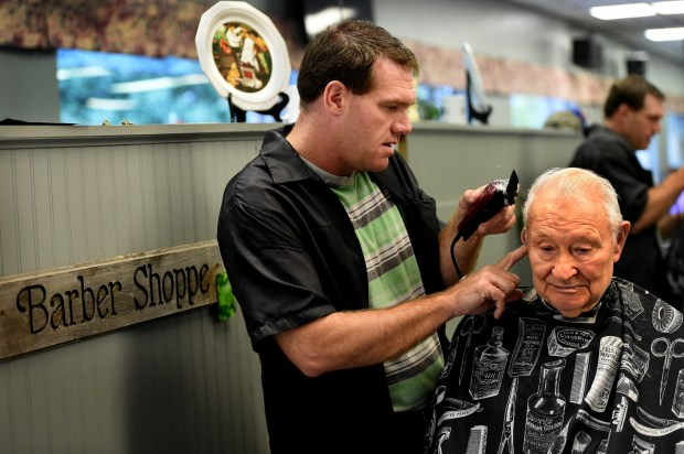 """Jeffrey Gedatus, a barber at The Hair Shoppe on Smith Avenue in St. Paul, cuts the hair of Jerry Jenniges from Mendota Heights on Friday, Oct. 6, 2017. Gedatus was driving home from work yesterday when a woman ran frantically in front of his vehicle, banged on his passenger window and relayed a tale about gunshots and cocaine. """"My husband is trying to kill me!"""" the woman screamed as he let her in and drove her to his home a couple of blocks away. She used Gedatus' cell phone to call 911. """"She calmed down when she got inside my house,"""" said Gedatus. """"I was glad to be there at the right time and if she needs anybody to talk to -- I'm here."""" The woman's husband was fatally shot on Euclid Street in the Dayton's Bluff neighborhood about 6 p.m. Thursday. St. Paul police officers fatally shot a man after they were called to """"a violent domestic"""" in which the man fired a gun at a woman. (Jean Pieri / Pioneer Press)"""