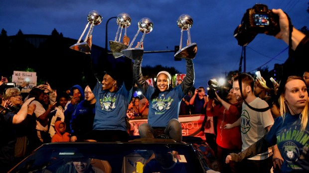 Minnesota Lynx's Sylvia Fowles, left, WNBA Finals MVP, and Maya Moore lift trophies at the end of a parade which began on 12th Ave. S.E. and University Avenue and traveled to Williams Arena, Thursday, Oct. 5, 2017 continuing their celebration of their 2017 WNBA title. After the parade, a championship celebration was held at Williams Arena with coaches and players addressing the crowd. (Jean Pieri / Pioneer Press)