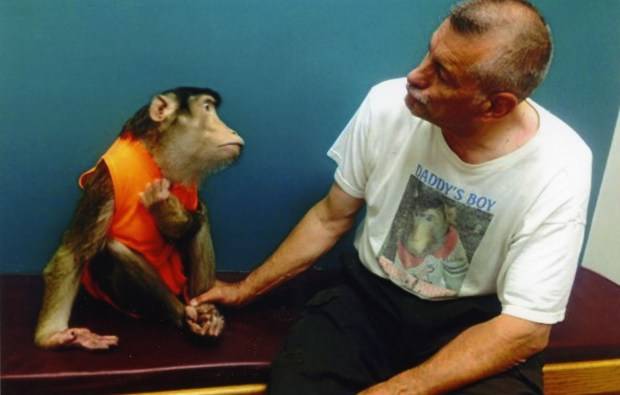 "Mikee, a macaque monkey, gives Roy Carlson ""croon face"" before his veterinary appointment. Mikee was exceptionally healthy but died of fluid on the heart, his vet told Carlson. (Courtesy of Roy Carlson)"