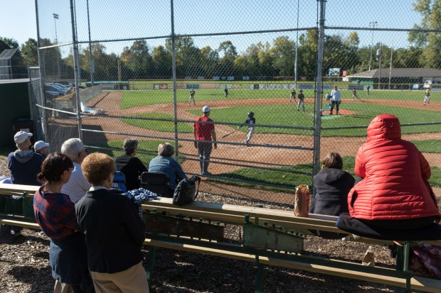 Parents and community members watch a youth fall baseball league game between the A's and the Twins at Ford Little League Fields on Sunday, Oct. 8, 2017. (Matthew Weber / Pioneer Press)