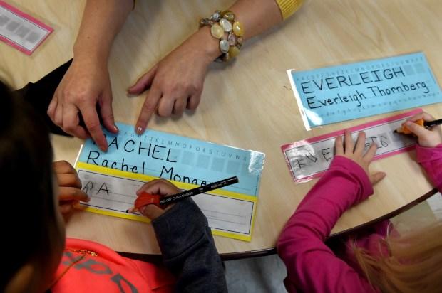 Rachel Monger, left, and Everleigh Thornberg practice printing their names in Julie Heroff's preschool class at Castle Elementary School in Oakdale on Wednesday, Oct. 11, 2017. (Jean Pieri / Pioneer Press)