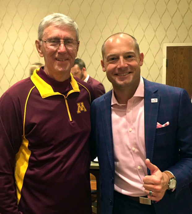Tom Sakal, left, captain of the 1967 Gophers football team, poses with Minnesota coach P.J. Fleck on Saturday, Sept. 30, 2017. Sakal spoke at the Captain's Breakfast, a new tradition where an alum addresses the team on game days. (Courtesy of University of Minnesota Athletics)
