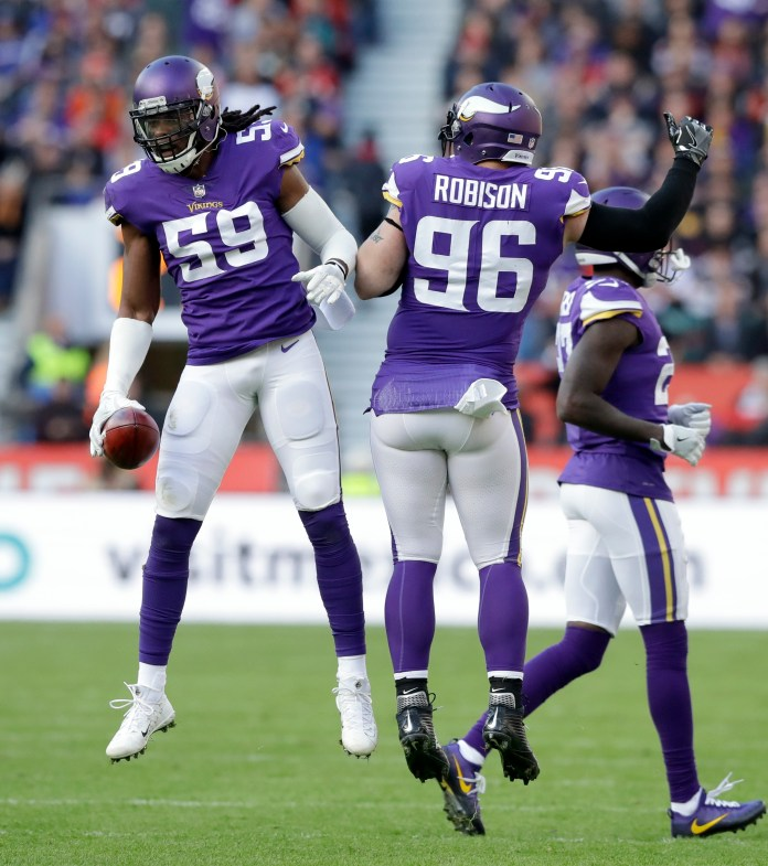 Minnesota Vikings linebacker Emmanuel Lamur (59) and defensive end Brian Robison (96) celebrate after forcing a turnover during the first quarter of an NFL football game against the Cleveland Browns at Twickenham Stadium in London, Sunday Oct. 29, 2017. (AP Photo/Matt Dunham)