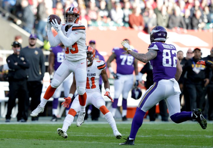 Cleveland Browns linebacker Joe Schobert, left, intercepts a pass as Minnesota Vikings tight end Kyle Rudolph watches during the first half of an NFL football game against Minnesota Vikings at Twickenham Stadium in London, Sunday Oct. 29, 2017. (AP Photo/Tim Ireland)