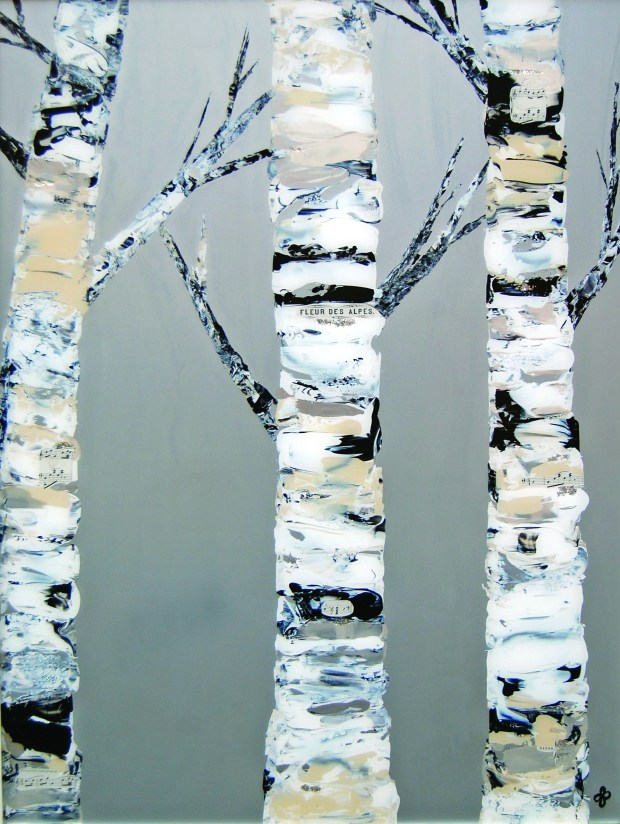 Customers at Janella Fesenmaier Fine Art have commissioned paintings of birches that incorporate bits of old sheet music.