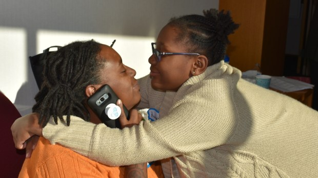 Delinia Parris shares a moment with her granddaughter Aniyajade, 10, whom she officially adopted at Adoption Day, Saturday, Nov. 18, 2017, at the Ramsey County Juvenile and Family Justice Center. (Deanna Weniger / Pioneer Press)