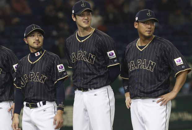 Team Japan players Ryosuke Kikuchi, left, Shohei Ohtani and infielder Sho Nakata stand during a ceremony prior to their international exhibition series baseball game against Mexico at Tokyo Dome in Tokyo, Friday, Nov. 11, 2016. (AP Photo/Koji Sasahara)