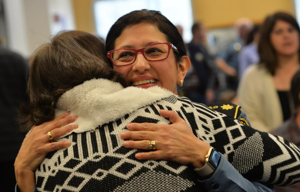 Pamela Barragan, facing camera, hugs friend and mentor Assistant Chief Kathleen Wuorinen, after Barragan was promoted along with four others to St. Paul Police Commander in a ceremony at St. Paul Police Western District Headquarters in St. Paul on Monday, Nov. 13, 2017. Barragan becomes the first Latina commander in the St. Paul Police Department. (Scott Takushi / Pioneer Press)