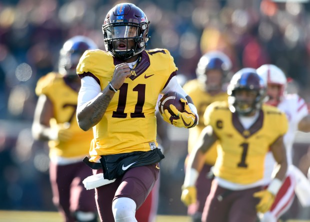Minnesota quarterback Demry Croft (11) runs for 64-yards against Nebraska during the fourth quarter of an NCAA college football game on Saturday, Nov. 11, 2017, in Minneapolis. Minnesota won 54-21. (AP Photo/Hannah Foslien)