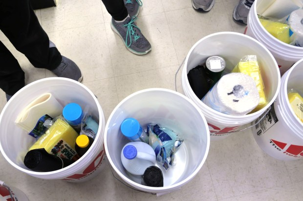 The city of Farmington has adopted a sister city in Texas and residents are buying buckets of supplies, which will be shipped there on Saturday. For the past two months, Farmington residents, businesses, schools and churches have come together to raise money and cleaning supplies for Port Aransas, a tourist town hit hard by Hurricane Harvey on the Texas Gulf Coast in August. On Wednesday, November 8, 2017, students from Baeckman Middle School filled buckets at Pelicci Ace Hardware store with cleaning supplies with the help of Amanda Stender, General Manager, at the hardware store. A semi truck at the store is now full of buckets; the truck leaves for Texas Saturday. (Ginger Pinson / Pioneer Press)