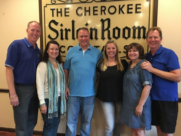 The Caspers and Rubenzers are pictured in July 2017, on the day the Rubenzers bought Cherokee Tavern. From left, Jim Casper, Sue Casper, Brian Rubenzer, Mollie Rubenzer, Kelly Casper and Rick Casper will all help with this year's Thanksgiving dinner for those in need.