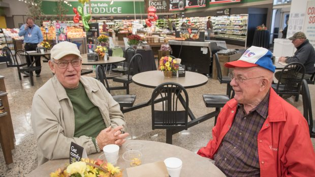 Dave Froehner, right, and Roger Quencer, left, sit in the newly remodeled Stillwater Cub on Tuesday, October 24, 2017. The two have visited this store for the past 11 years for free coffee and donuts. (Matthew Weber / Pioneer Press)