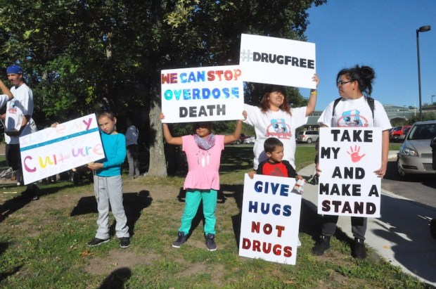 122617.N.FNS.MNOpioidsMilleLacs: -- Demonstrators against opioids hold signs at a recent event on the Mille Lacs Band of Ojibwe reservation in northern Minnesota recently. (Courtesy of Mille Lacs Band of Ojibwe via Forum News Service)