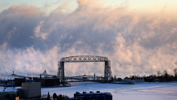 The rays of the rising sun illuminate wisps and whorls of fog rising from Lake Superior Tuesday morning, Dec. 26, 2017.(Bob King / Forum News Service)