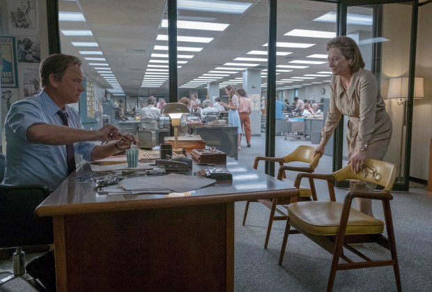 """This image released by 20th Century Fox shows Tom Hanks, left, and Meryl Streep in a scene from """"The Post."""" The film earned eight Critics' Choice Awards nominations on Wednesday, Dec. 6, 2017, including one for best picture. The winners will be announced at a Jan. 11 gala that will be televised on The CW Network. (Niko Tavernise/20th Century Fox via AP)"""