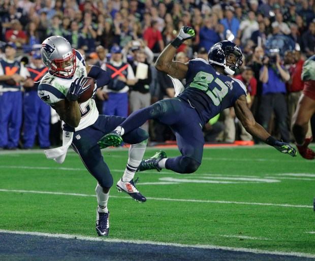 FILE- In this Feb. 1, 2015, file photo, New England Patriots strong safety Malcolm Butler (21) intercepts a pass intended for Seattle Seahawks wide receiver Ricardo Lockette (83) during the second half of NFL Super Bowl XLIX football game in Glendale, Ariz. The last time the Seahawks and Patriots were on the same field, Butler was making a Super Bowl-saving play for New England.  (AP Photo/Kathy Willens, File)