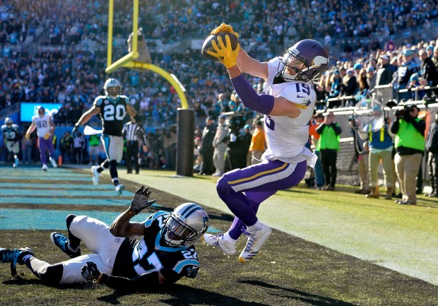 Adam Thielen #19 of the Minnesota Vikings attempts a catch against Kevon Seymour #27 of the Carolina Panthers in the second quarter during their game at Bank of America Stadium on December 10, 2017 in Charlotte, North Carolina. (Photo by Grant Halverson/Getty Images)
