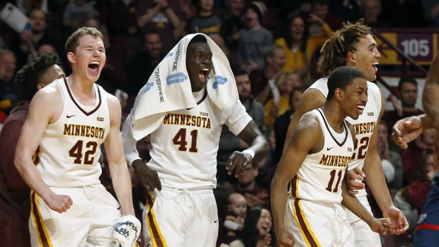 Minnesota players, from left, Michael Hurt, Minnesota's Gaston Diedhiou of Senegal, Isaiah Washington and Reggie Lynch celebrate a reverse layup by Hunt Conroy in the second half of an NCAA college basketball game against Florida Atlantic, Saturday, Dec. 23, 2017, in Minneapolis. Minnesota won 95-60. (AP Photo/Jim Mone)