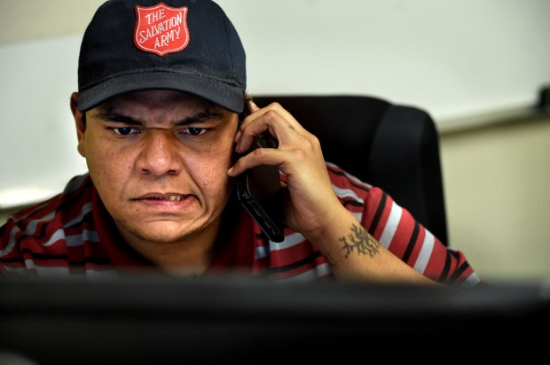 Jason Roberts, a recovering heroin addict who nearly died twice from injecting heroin laced with fentanyl, entered a recovery program run by the Salvation Army and now works as a dispatch manager for the organization. He's pictured on Dec. 7, 2017. (Jean Pieri / Pioneer Press)