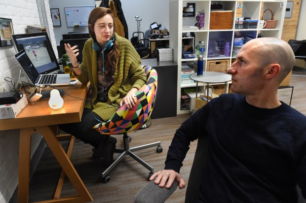 Filmmaker Chris Newberry, right, talks with Erica Ticknor, an assistant editor, as they work on a documentary about Jacob Wetterling in his film studio in Minneapolis on Wednesday, Nov. 29, 2017. (Jean Pieri / Pioneer Press)
