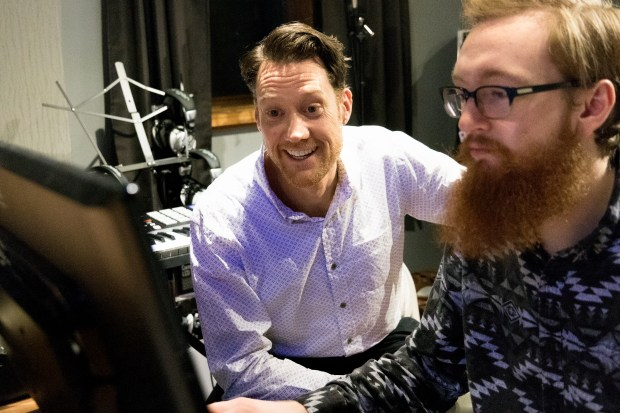 "Roger Williams, left, works with editor Matt Grosso on a documentary about legendary Stillwater choir director Dr. Erik ""Doc"" Christiansen called""His Voices – A Short 'Doc'umentary"" at Grosso's home studio in St. Paul on Wednesday, Dec. 13, 2017. Williams, who sang in the choir in 1993, is producing the documentary. (Matthew Weber / Pioneer Press)"