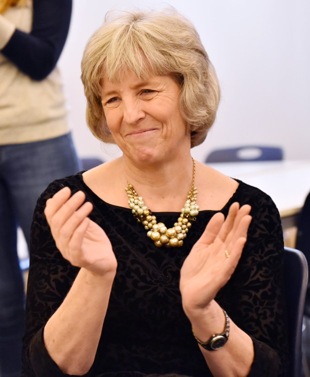 Nancy Homans, policy director to St. Paul Mayor Chris Coleman, claps as she is honored at her retirement ceremony at the Rondo Library in Saint Paul on Wednesday, Dec. 20, 2017. (Pioneer Press / John Autey)
