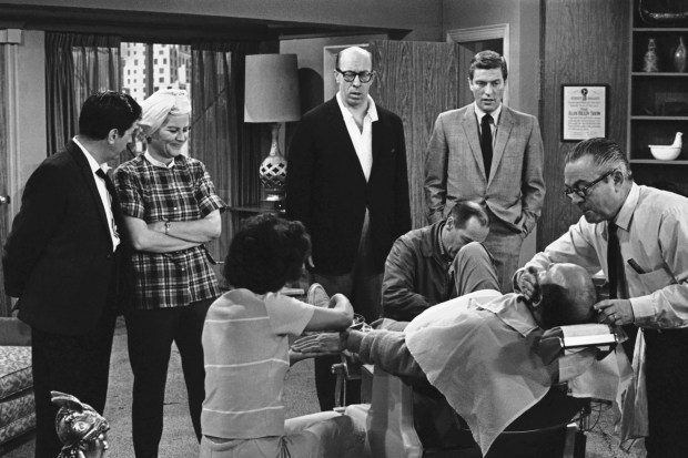 "FILE- In this April 11, 1963, file photo, standing from left, Morey Amsterdam, Rose Marie, and Richard Deacon, and Dick Van Dyke, right, gather around Carl Reiner, in barber chair during a rehearsal of an episode for the ""The Dick Van Dyke Show."" Family spokesman Harlan Boll said Marie, the wisecracking Sally Rogers of ""The Dick Van Dyke Show,"" died Thursday, Dec. 28, 2017. She was 94. (AP Photo/David F. Smith, File)"