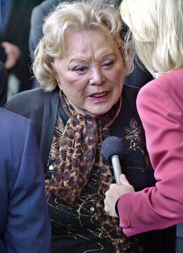 "FILE- In this April 1, 2002, file photo, actress and comedian Rose Marie talks to the press as she arrives for a ceremony honoring comedian Milton Berle at Hillside Memorial Park and Mortuary in Los Angeles. Family spokesman Harlan Boll said Marie, the wisecracking Sally Rogers of ""The Dick Van Dyke Show,"" died Thursday, Dec. 28, 2017. She was 94. (AP Photo/Nick Ut, File)"